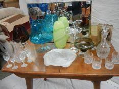 A 4 shelf bathroom mirror (78 x 48 x 14 cm) and 8 pieces of coloured glass including decanter.