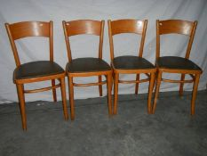 4 fine ash bentwood chairs with green vinyl seats.