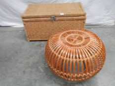 A circular wicker table 63 cm diameter x 40 cm high and a rattan blanket box with hinged lid L 85