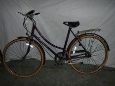 A Raleigh ladies bicycle in purple,