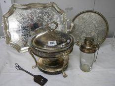 A mixed lot of silver plate including heated serving dish, cocktail shaker, 2 trays etc.