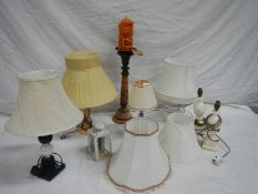 6 table lamps, a carriage candle holder and a new Novalum shimmering candle with stand.