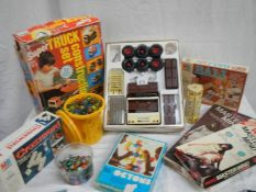 A mixed lot of interesting items including truck construction set, large quantity of marbles etc.