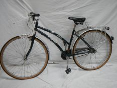 """A """"Cafe"""" Real 4 speed ladies bike with rear rack and front basket."""