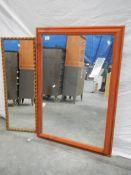 A framed pine mirror (73 x 103 cm) and a gilded mirror (35 x 95 cm).