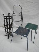 An umbrella stand, 2 woven stop stools and a steel rack.
