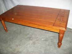 A good solid mahogany side table on tapered legs with carving to top, 122 cm long,
