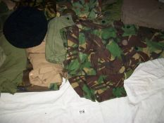 A good large lot of camouflage / khaki jackets, trousers, caps, bags etc., 18 items in total.