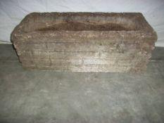 A concrete planter 61 x 28 cm x 22 cm high,