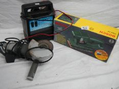 A Bosch PS23 sander, an angle grinder and a battery charger.