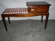 A good red stripe telephone seat in good condition.
