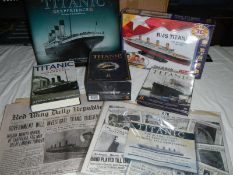A mixed lot of Titanic items, jigsaw puzzle, newspapers, book etc.
