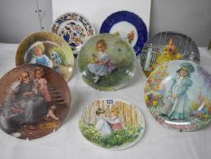 8 collector's plates including Wedgwood.