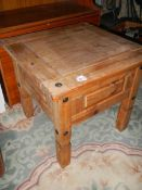 A small rustic pine coffee table.