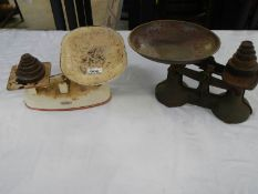 2 sets of kitchen scales with weights.