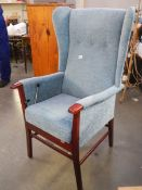 A good quality wing armchair with automatic lifting mechanism.