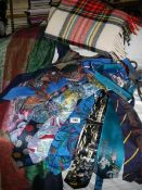 A mixed lot of silk/cotton ties including 'Batman', a silk throw and a wool rug.