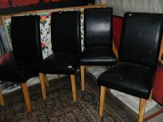 A set of 4 leather dining chairs in good condition.