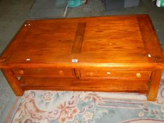 A low 2 drawer coffee table.