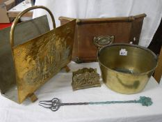 A mixed lot of brass ware including magazine rack, jam pan, fire front etc.
