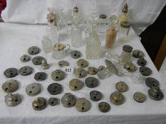 A mixed lot of cruet bottles, inkwell tops, cruet tops etc.