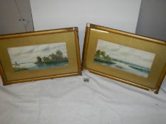 A pair of framed and glazed rural scene watercolours signed S Russell.