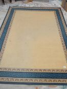 A good quality blue/beige rug, 233 x 162 cm.