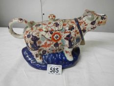 A Chinese cow creamer.