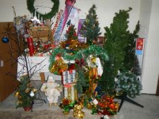 A mixed lot of Christmas decorations including trees.