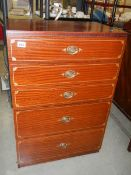 A 5 drawer chest with painted line decoration around drawers.