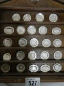 24 miniature historical English silver plates (should be a set of 25 but one missing).