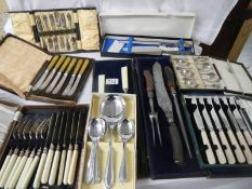 8 boxed sets of assorted cutlery including spoons, carving knives, silver handled set etc.