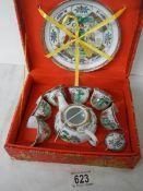 A boxed Japanese tea set.