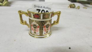 A miniature Royal Crown Derby loving cup in good condition.