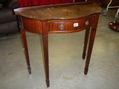 A good mahogany serpentine front hall table.
