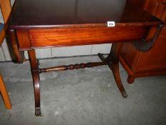 A mahogany drop side sofa table.