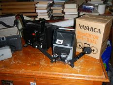 A quantity of projectors and a Yashica 8mm editor.