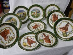 Ten collector's plates depicting dogs and other animals.