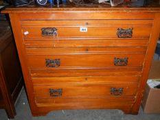 A 3 drawer satin walnut chest.