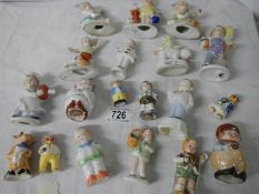 Approximately 19 mid 20th century miniature figures.
