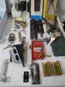 A mixed lot of old door locks, keys etc.