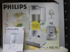 A Philips HR2845 blender with instructions and cook book.