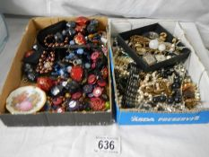 2 trays of unsorted costume jewellery.