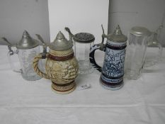 Three glass beer steins and 2 Avon pottery beer steins.