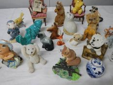 Approximately 24 assorted china animals etc., including dogs, bears on chairs etc.