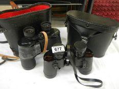 2 pairs of binoculars, one 7 x 35 Japanese and 12 x 40 Tento Russian.