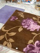 A purple rug 160 x 123 cm and a brown rug 146 x 208 cm.