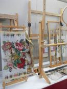 A selection of tapestry frames, embroideries etc.