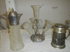 A four trumpet glass and EPNS eperge, a glass claret jug with plated top and a beer stein with stag,