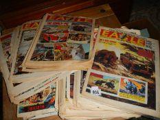 A quantity of well read Eagle comics.
